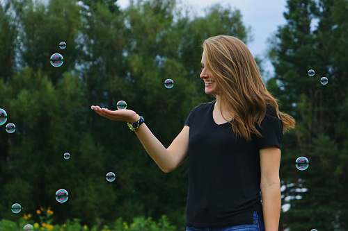 people woman standing in front of bubbles bubble