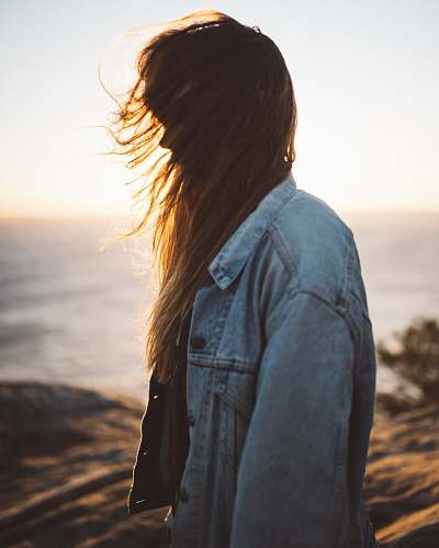 people woman wearing blue button-up denim jacket sunlight
