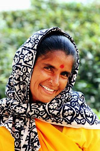 woman woman wearing white and black floral scarf while smiling india