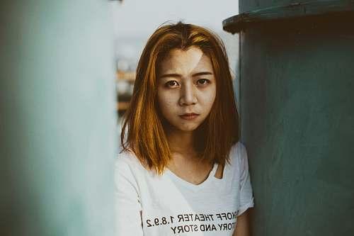 people woman wearing white top near metal case human