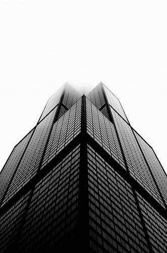 black-and-white aerial photo of building under white sky skyscraper