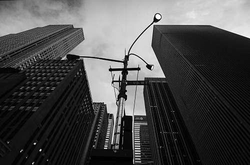 building grayscale photo of concrete buildings architecture