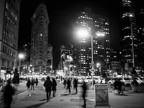 human grayscale photo of people on street and buildings pedestrian