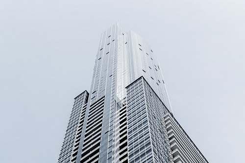 urban A tall skyscraper in Toronto against a pale blue sky architecture