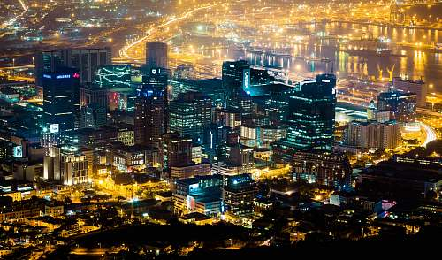 city aerial photography of city skyline during nighttime town