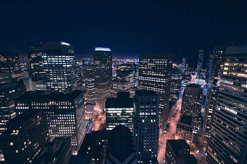 city aerial shot of city skyline at night downtown