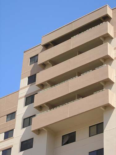 city architectural photo of a beige building high rise