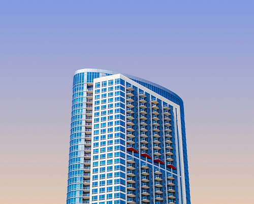 photo condo blue high-rise building during daytime housing free for commercial use images