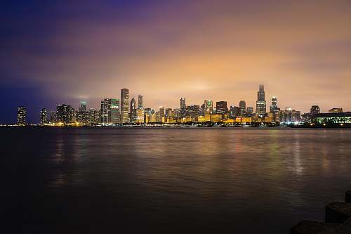 city city skyline near body of water during golden hour chicago