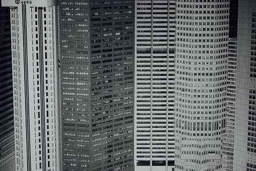 city closeup photo of concrete building black-and-white