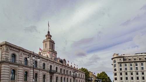 city European-styled concrete buildings under cloudy sky urban