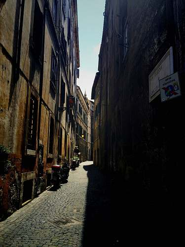 alley gray pathway between buildings alleyway