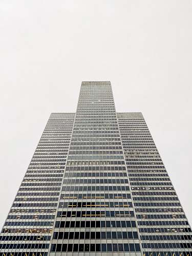 city gray tower building on gray sky architecture