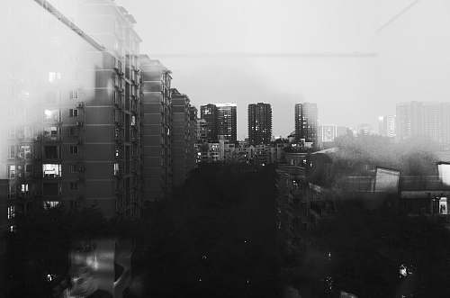 city grayscale photo of city buildings black-and-white
