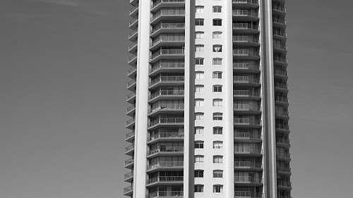 city high-rise building during day black-and-white