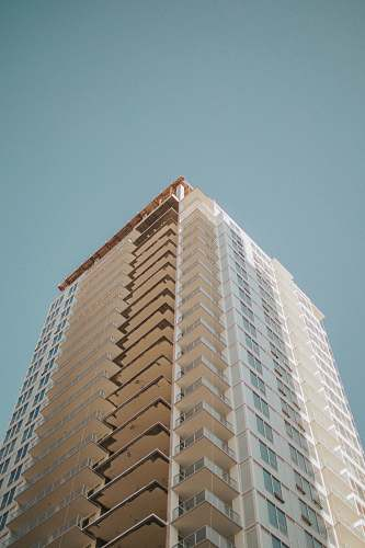 photo condo high-rise building during day housing free for commercial use images
