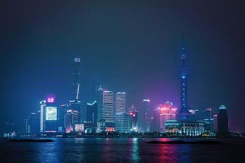 city lighted city skyline during night urban