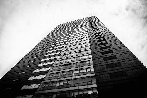 black-and-white low angle photo of black and gray building office building