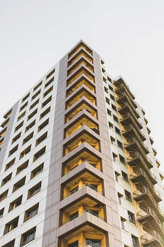 photo condo low-angle photography of high-rise building at daytime housing free for commercial use images