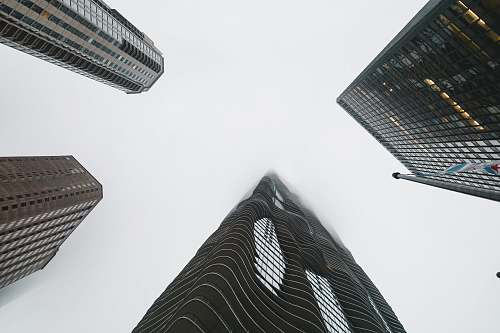 architecture low angle photography of high rise buildings grey