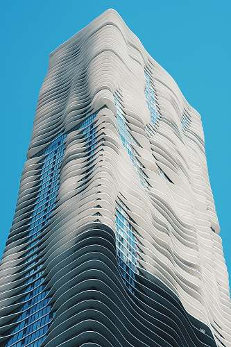 town low angle photography of white high rise building architecture