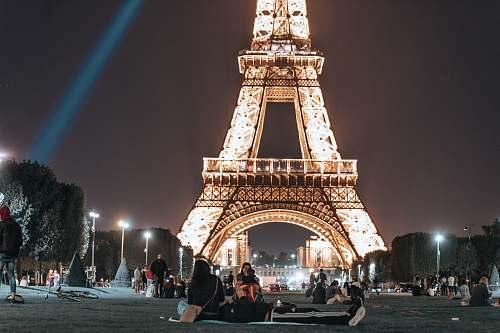 city people near Eiffel Tower downtown
