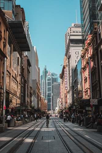 city people on marker beside road urban