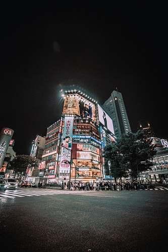 city people passing through the pedestrian lane during nighttime urban
