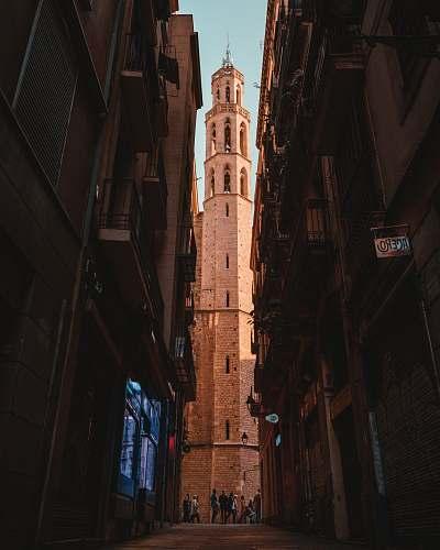 city people standing between building alley