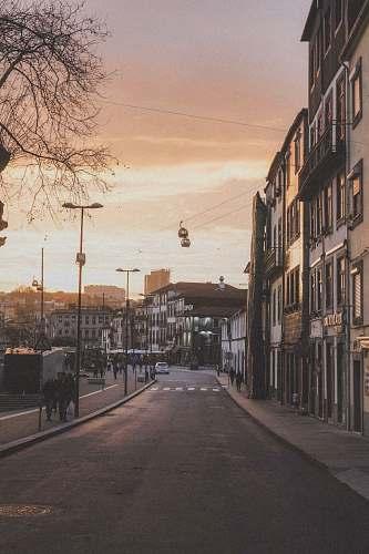 city people walking beside street road