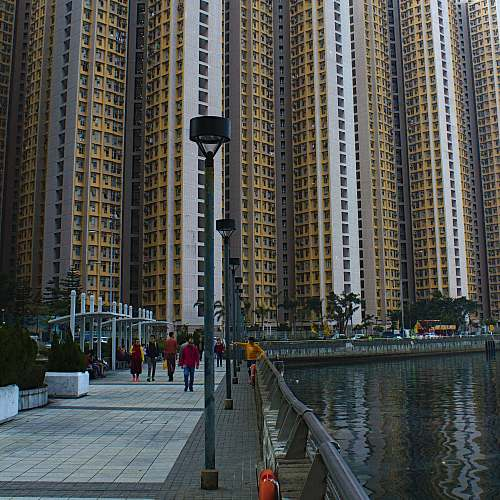 city people walking near high-rise building during daytime high rise