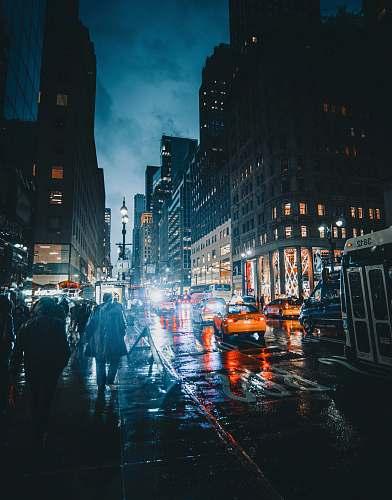 city people walking on street at nighttime metropolis