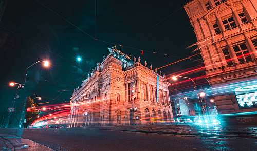 city time lapse photography of vehicles passing by outside European-styled building downtown