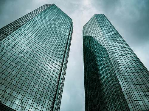 architecture two high-rise buildings under gray clouds during daytime skyscraper