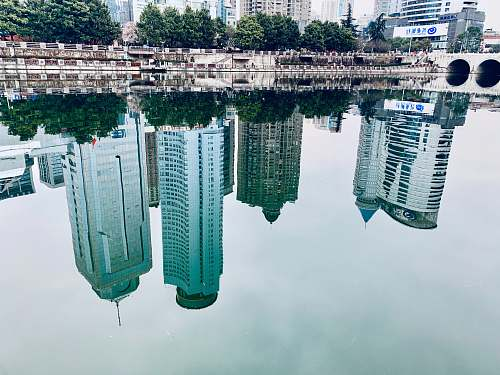 city water mirror reflection of buildings high rise