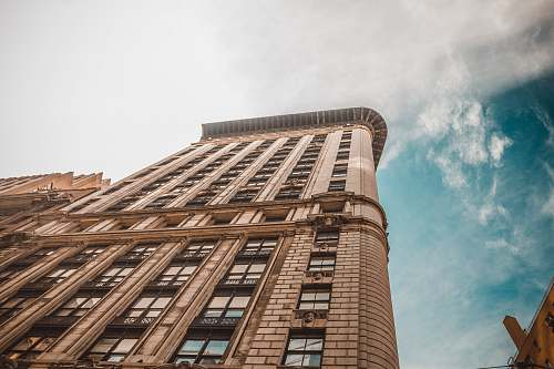 architecture worm's eye view photography of brown building skyscraper