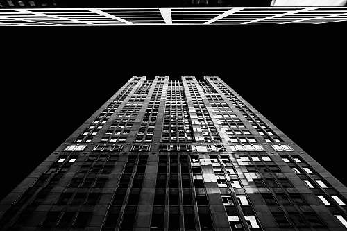 black-and-white worm's eye view photography of building architecture