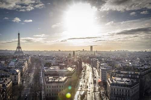 paris aerial view of city buildings sun