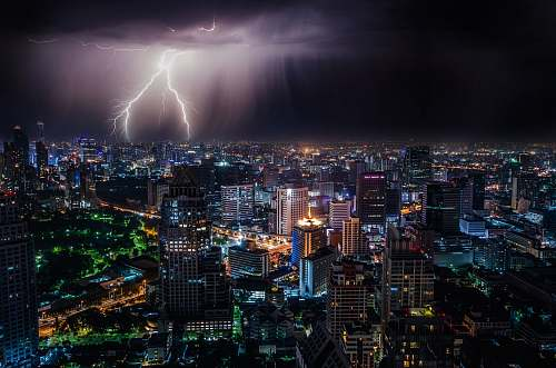 building aerial view of city buildings with lightning strike bangkok