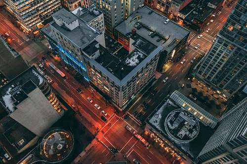 road aerial view photography of highrise building intersection