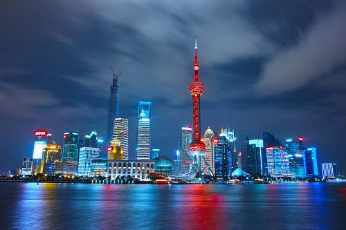 building architectural photograph of lighted city sky architecture