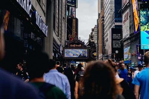 building crown people walking beside sidewalk metropolis