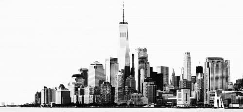 urban grayscale photo of high rise buildings across sea black-and-white