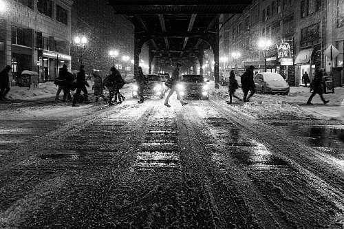 black-and-white grayscale photo of people walking on street snow