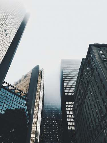building high-rise buildings covered with fog architecture
