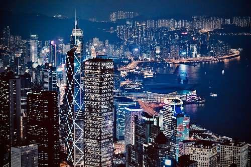 building lighted city skyline at night urban