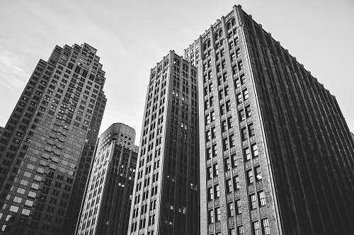 architecture low angle grayscale photography of high-rise buildings black-and-white