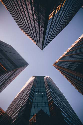 architecture low-angle photography of four high-rise buildings urban