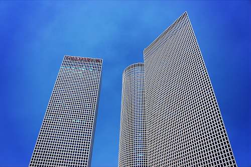 skyscraper low-angle photography of three high-rise buildings architecture