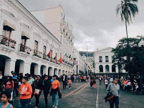 urban people walking beside building at daytime town